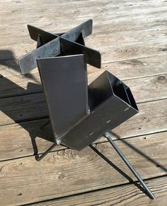 Wood Burning Rocket Stove Self Feeding Design all welded steel construction (Dunway Enterprises) http://dunway.biz/survive_natural_calamity/index.html