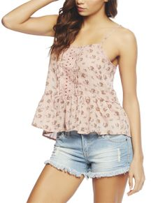 """Ultra chic cami has a ditsy printed woven body, see-through floral embroidered trim along the center with pleated sides, adjustable spaghetti straps, and a ruffled trim.  Model is 5'9"""" and wears a size small   80% Polyester / 20% Nylon Machine Wash Imported"""