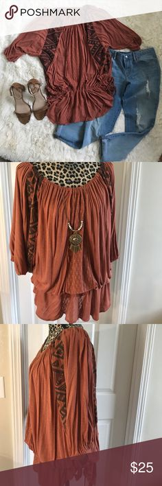 ✨Host Pick✨ Free People Bohemian Top Fits L to XL. Very roomy dolman sleeve top with drawstring waist. Ties on sides. Elastic neck can be worn on or off shoulders. Very cute with short shorts or boyfriend jeans and booties. Free People Tops