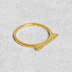 Petit Sesame | Gold-plated skinny deli ring | Designed by Petit sesame | $16.00 | 18k gold plated 925 silver baguette ring paved with cubic zirconia