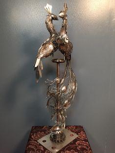 Welded metal art silverwear peacocks side view. By Kari Betz. Made from gears, coat hangers, silverware and miscellaneous metal scrap.