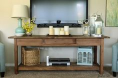 Rustic console table for under wall mounted TV. The DVD & DVR components are hardly noticeable.