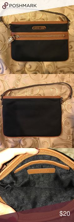 Michael Kors wristlet black and brown. perfect condition. never used! Michael Kors Bags Clutches & Wristlets