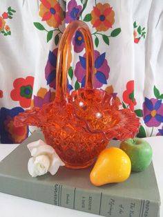 Striking orange or amberina Fenton glass basket in the Olde Virginia pattern from the 1960s. Basket is 8 tall and 7 wide by 6 deep.