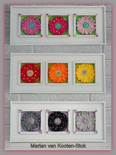 I have made a decoration with marguerites in 3 different colors for the wall. I have used a free pattern form Drops http://pinterest.com/pin/126734176986200506/