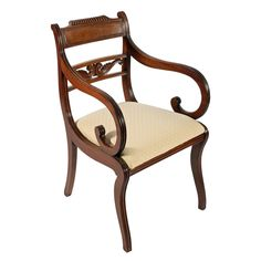 An early century Regency mahogany sabre leg elbow chair.The chair has an inset top rail to the back with carved decoration and the centre has a carved Antique Chairs, Antique Clocks, Antique Furniture, Hall Stand, Wishbone Chair, Marble Top, Wall Shelves, Regency, Upholstery