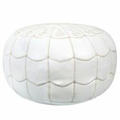 """Handmade leather pouf with a white arch motif.Product: PoufConstruction Material: Moroccan leather and shredded foam fillColor: WhiteFeatures:    HandmadeArch design  Dimensions: 14"""" H x 21"""" Diameter"""