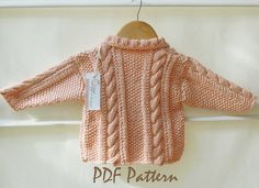 Baby Jacket with cable panels and moss stitch by OgeDesigns