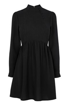 HIGH NECK BUTTON DETAIL DRESSFabric:Main: 100.0% Polyester.Wash care:Machine WashProduct code: 02503277 Price: £48.00