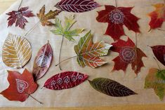 Put leaves in between newspaper before Drawing on them...   I spread my leaves out on wax paper first, brushed mod podge on one side, let dry, then turned them over and brushed on another coat.