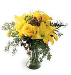 Think happy thoughts and send your best wishes along with this lighthearted bouquet.  Sunny yellow lilies, yellow roses and yellow button pompons are accented by red hypericum berries and seeded eucalyptus. A carefree bouquet to brighten their day!
