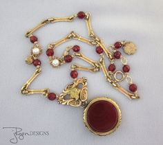 Antique Watch Fob Locket Necklace - One of a Kind Jewelry Designs - JryenDesigns Click here for more details and use Coupon Code PINNER10 for 10% off your purchase.
