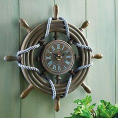 Gotta have a clock by the pool so we know when to reapply!  Rustic Ship Wheel Decorative Nautical Wall Clock - traditional - clocks -  - by Collections Etc.