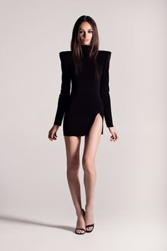 Black mini dress with strong shoulders & a high slit.-Michael Costello US Size Chart-Terms / Conditions-Shipping- Made true to size- Dry clean only