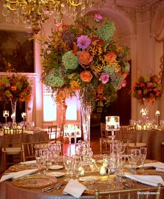 green hydrangea, large roses, pink dahlia, yellow or orange James Storei aranthera orchids, oak leaves, curly willow, and ...?