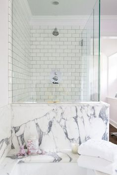 Marble bathroom with white tiles shower. Simple sophistication.