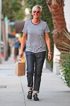 Ellen DeGeneres ~ Our favorite tv-host is comfy chic in a pair of loose jeans and a white and blue striped tee. Inspiration for a weekday!