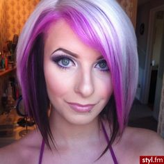 This look can be achieved with bleached platinum blonde hair and sectioned off parts of platinum used with overuse of shimmer lights..& a dark purple/burgundy under color. ;) <3 it!
