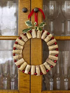 60 Christmas Crafts to Bring a Handmade Holiday to Every Room in the House : Wine Cork Wreath Strung together between red jingle bells, wine corks can dress up the dining room. Bonus: You get to drink all that wine first. Click through for more! Christmas Wreaths To Make, Christmas Door Decorations, How To Make Wreaths, Holiday Wreaths, Christmas Crafts, Christmas Ornaments, Xmas, Outdoor Christmas, Snowman Ornaments