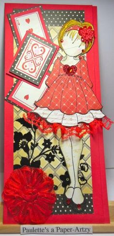 I've accepted an offer to be guest designer for eclectic Paperie for the month of February.  My box of goodies from the eclectic Paperie shop came today.  They have a design challenge every month and January's challenge is to use HEARTS in your design.      The Julie Nutting Prima doll was paper pieced from a new paper collection by Authentique called