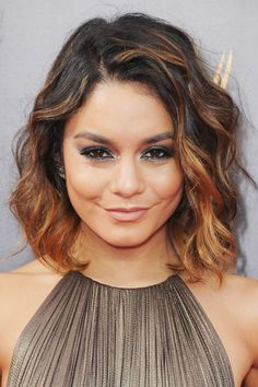 Ombré color pairs well with Victoria's Secret-length hair, but the look also complements shorter styles like no other. With a cropped hairdo, the gradient starts at your temples and the lightened, bottom half of your hair will accentuate your cheekbones. Vanessa Hudgens' ombré hair is accented with face-framing toffee highlights.