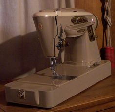 This Singer 503 is a thing of beauty, as well as one of Singer's best.  It doesn't have the built-in stitch pattern camstack like the 500, but it's still a fine Slant-O-Matic machine.  Sorry, already sold.