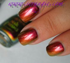 Sally Hansen Nail Prisms #08 Amber Ruby. Is this not the most gorgeous thing you've ever seen? It's so richly colored, it's like fall in a bottle. It's even perfect for Christmas- doesn't it look like a warm crackling fireplace, green garland and golden ornaments? The color shift in this is very strong and very dramatic. It can go from red and amber to all green and gold in a split second.