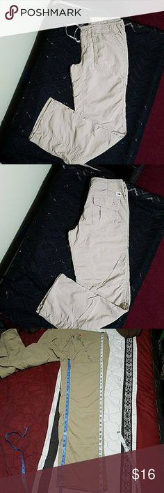 The North Face hiking pants The North Face hiking pants.  In great used condition.  Length is about 39 inches.  Inseam is about 31 inches.  Waist is about 30 inches.  Made of 100% nylon. Pants roll up and button. Has a inside stow pocket. The North Face Pants