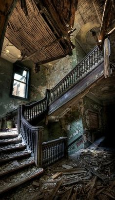 Decaying staircase in an abandoned house.