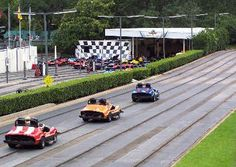 Tomorrowland Speedway: Accelerate at 7 miles per hour around a scenic 0.4 mile-long racetrack. Careen around sharp bends, past lush foliage, and pick up the pace underneath a small bridge. Along the way, listen to an announcer call the race overhead, as you pass such iconic attractions as Space Mountain in the not-too-far-off distance.