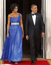Image result for president obama holding michelle's dress down