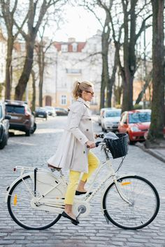 Make Life Easier. Khaki trench and flats with colorful yellow jeans. Elegant and classic for a bike ride