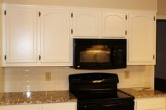 Cabinets- SW creamy and walls SW Rice Grain