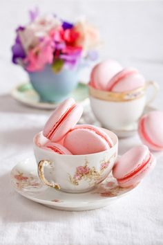 macarons in teacups - I would choose different cookies. Treats for the guests all day. Instead of a take home food favor.