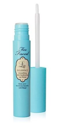 Use lip primer to cover pimples , the purpose of lip primer is to cancel out the color of you lips so you can get the best color out of your lipstick.