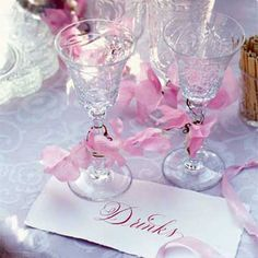 Even when they don't match, crystal goblets — tied with pink or blue ribbon — add a touch of glamour to a midday meal. Use them to serve a signature cocktail or champagne for a toast.