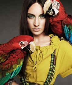 How much do I want to be this model right now? A parrot posse! With killer green eye makeup to boot.