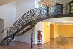 A wrought iron staircase with an exceptional interior railing Interior Railings, Interior And Exterior, Wrought Iron Staircase, Blacksmithing, Villa, Stairs, Fun, Home Decor, Blacksmith Shop