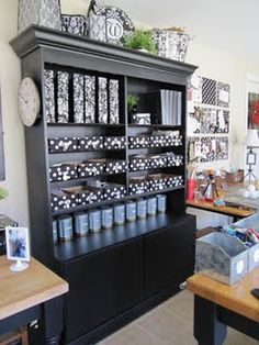 This was a very old china cabinet not being used in the basement. A coat of black paint, glass doors taken off and crown molding added. All the crap up on top...decorative plastic grocery bags, but filled with stuff.