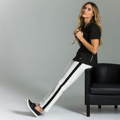 Introducing the Tuxedo Pant, featuring ponte knit panels for comfort, a bar clasp waistband, and front & back pockets for storage. #scrubs #medicalscrubs
