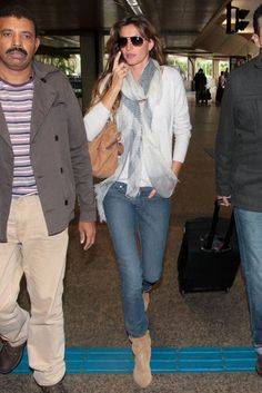 Gisele Bundchen landed at the airport in Sao Paulo yesterday (May 15, 2012).