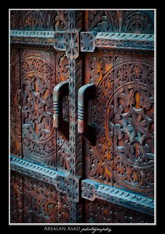 The hand crafted wooden door - Lok Virsa, Islamabad, photographed by Arsalan Asad.