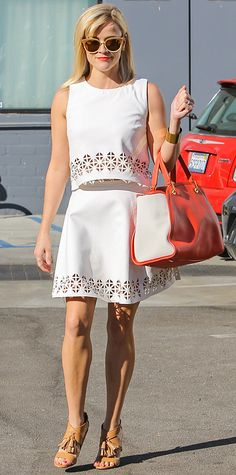 Snapped out and about in Los Angeles, Reese Witherspoon was flawless in flirty cut-out ivory separates by Monica Rose for Lovers + Friends, styling them with a color-blocked carryall, a gold cuff, and leather tasseled Kate Spade Saturday heels.