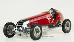 """CaptJimsCargo - Red BB Korn Indianapolis 1930s Tether Car Model 22"""" Racing Spindizzy, (http://www.captjimscargo.com/authentic-models-home-decor/model-spindizzy-tether-cars/red-bb-korn-indianapolis-1930s-tether-car-model-22-racing-spindizzy/) The hood opens up to reveal a replica (non-working) gas engine."""