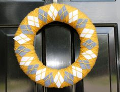 Be still my argyle loving heart!  Mustard and gray--yes, please!   From the EmbellishedLiving etsy shop    http://www.etsy.com/listing/81336680/argyle-yarn-wreath