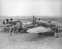 Refuelling and rearming No.601 Squadron Hawker Hurricanes Mk.I at RAF Tangmere, 1940