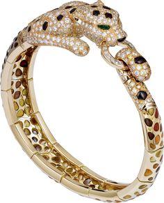 CARTIER. Bracelet - yellow gold, emeralds eyes, pique-à-jour enamel, jasper, onyx, orange brilliant-cut diamonds, yellow brilliant-cut diamonds, calibrated