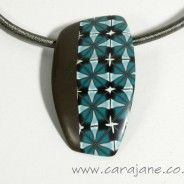 Teal and brown kaleidoscope cane pattern polymer clay pendant by Cara Jane