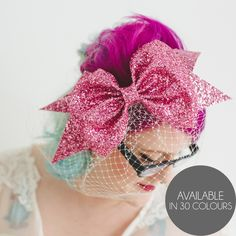 Oversized glitter bow with ivory birdcage veil on silvertone aliceband. Choose from 30 super sparkling colours. Comes with a branded dustbag to...
