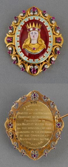 Oval gold brooch containing enamel and gold bust of a crowned lady inset with diamond and rubies on a blue and red guilloché enamel ground. Scroll border set with diamonds and rubies. Presented to Queen Mary by the Worshipful Company of Mercers on the occasion of her admission to the freedom of the Company at Mercers' hall, 26th July 1949. 5.6 x 4.7 x 1.4 cm